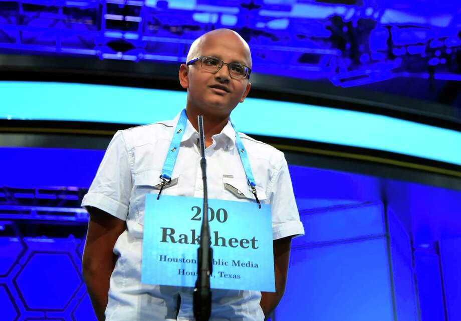 Raksheet Kota, 14, from Katy, Texas, spells his word during the finals of the 90th Scripps National Spelling Bee, in Oxon Hill, Md., Thursday, June 1, 2017. Kota, correctly spelled his word. (AP Photo/Manuel Balce Ceneta) Photo: Manuel Balce Ceneta, STF / Copyright 2017 The Associated Press. All rights reserved.