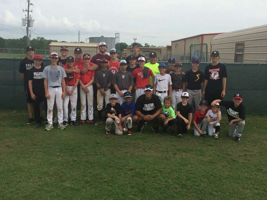 The campers and Hargrave baseball players at the Hargrave Summer Baseball Camp Photo: Tom DeBerry, Hargrave Baseball