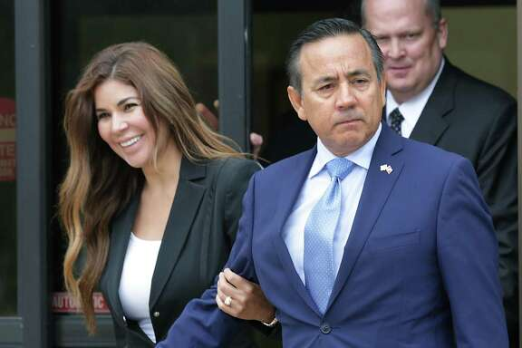 Senator Carlos Uresti, foreground right, walks out of the Federal Courthouse with his wife Lleanna Uresti, left, and attorney Mikal Watts, background right, following his arrest by the FBI on Wednesday, May 17, 2017.
