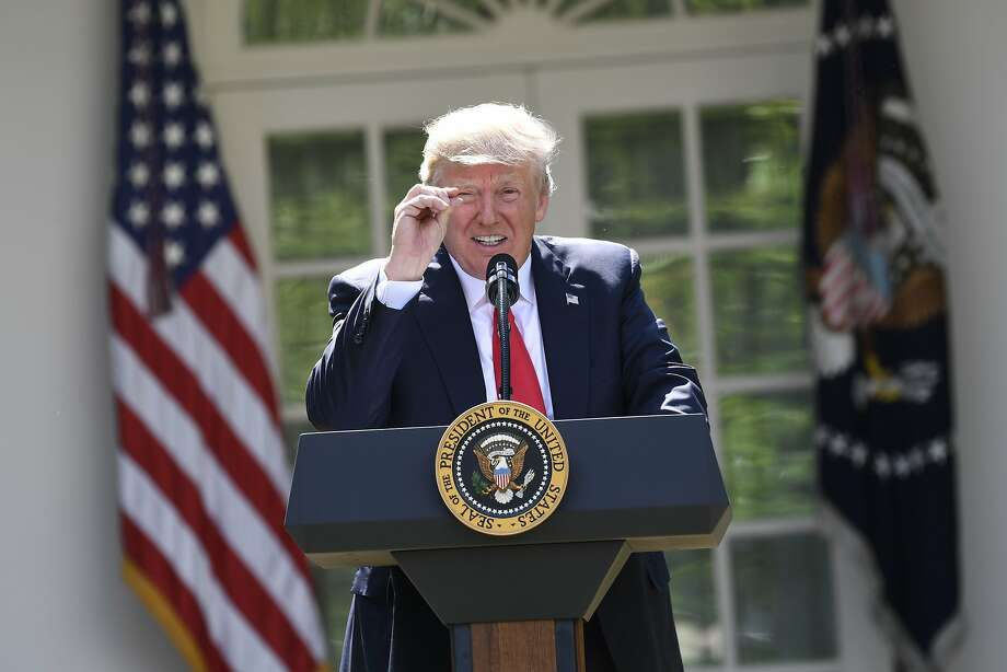 "TOPSHOT - US President Donald Trump announces his decision to withdraw the US from the Paris Climate Accords in the Rose Garden of the White House in Washington, DC, on June 1, 2017.      ""As of today, the United States will cease all implementation of the non-binding Paris accord and the draconian financial and economic burdens the agreement imposes on our country,"" Trump said. / AFP PHOTO / SAUL LOEBSAUL LOEB/AFP/Getty Images Photo: SAUL LOEB, AFP/Getty Images"