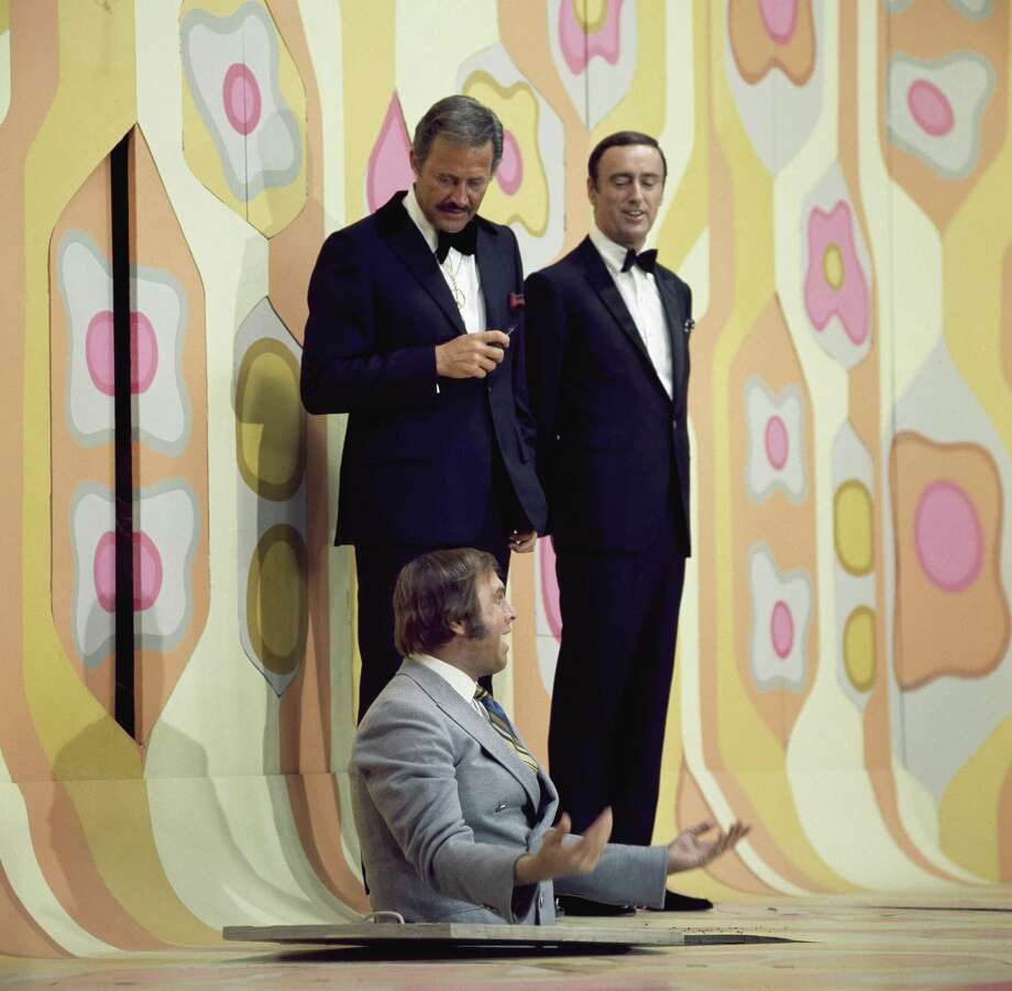 """Hosts Dan Rowan and Dick Martin, with Alan Sues on """"Rowan & Martin's Laugh-In."""" Satirical and psychedelic, it memorably introduced Goldie Hawn in her bikini and had Richard Nixon as a guest during the 1968 presidential campaign, uttering the show's catch-phrase, """"Sock it to me."""" """"Laugh-In's"""" title played off the '60s sit-ins and be-ins. Photo: NBC / NBC Via Getty Images / 2012 NBCUniversal, Inc."""