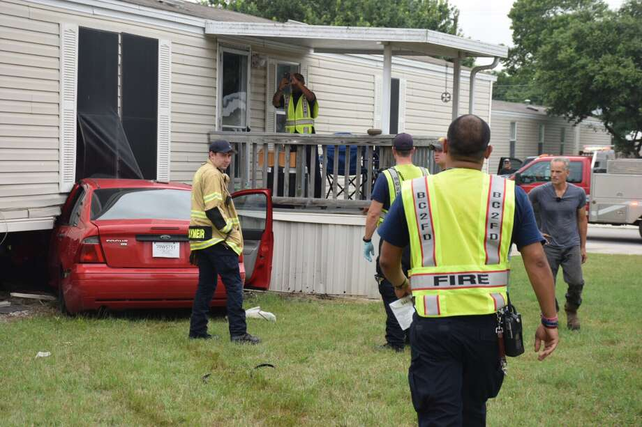 A woman was hospitalized Friday, June 2, 2017, after losing control of her vehicle and crashing into a West Side mobile home. Photo: Caleb Downs / San Antonio Express-News