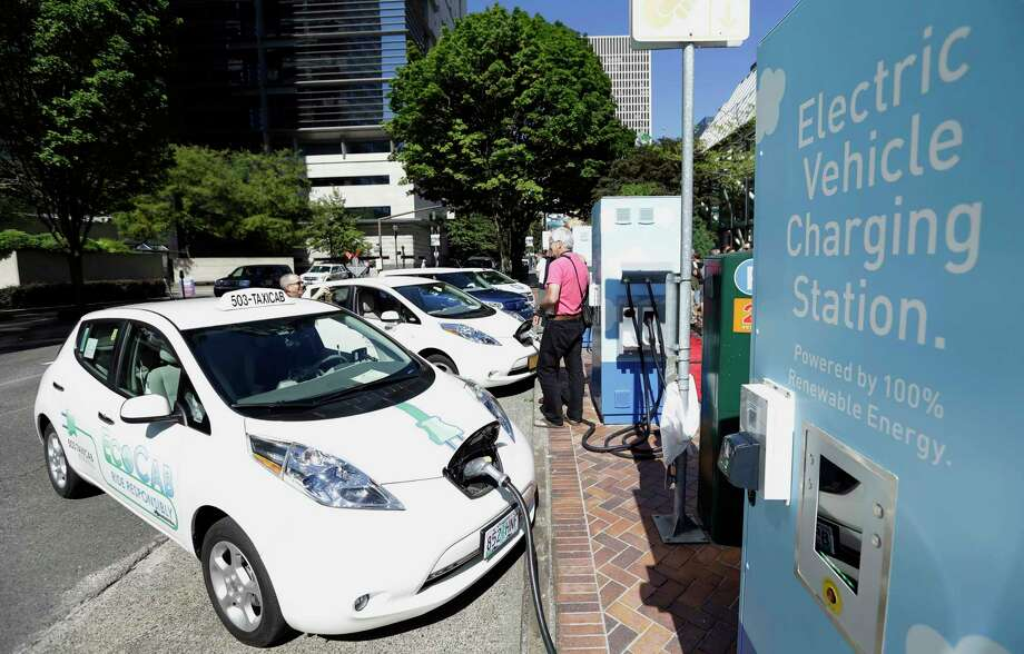 File In This July 28 2017 Photo A Line Of Electric Cars