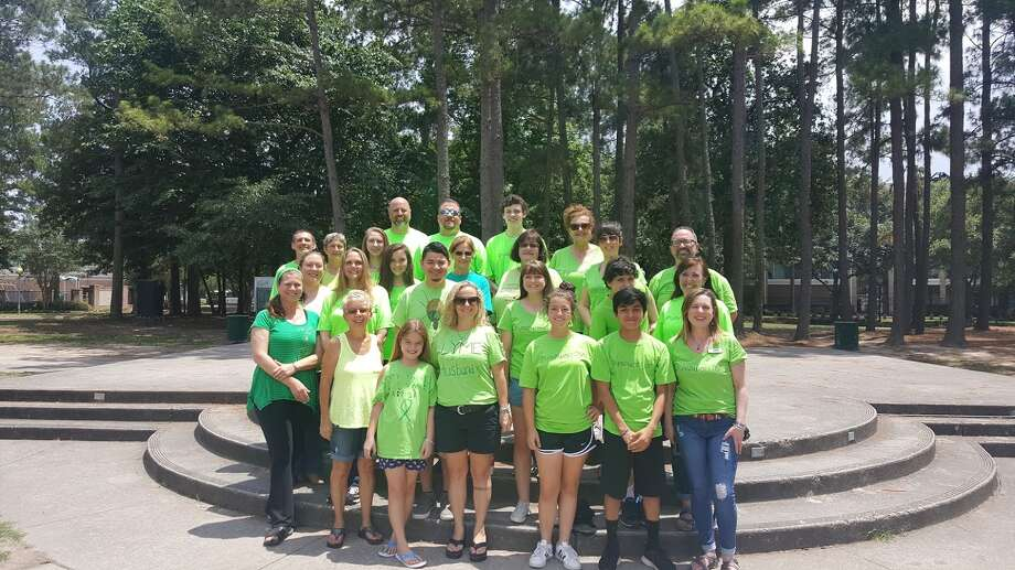 People wear lime green in support of Lyme disease awareness during the Kingwood Lyme Support Group's Lyme Awareness Month event in Kingwood Town Center Park May 21. Photo: Melanie Feuk