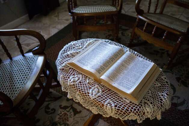 Celia Rodriguez keeps a Bible on the center of her living room, where at night she sits to reads it seeking to console herself because her husband has been ordered to turn himself in to be deported to El Salvador at the end of the month of June. Wednesday, May 24, 2017, in Houston. Photo: Marie D. De Jesus, Houston Chronicle / © 2017 Houston Chronicle