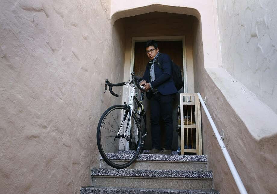 David Cruz Hernandez, shown leaving his Sunset District home, emigrated from Mexico 11 years ago but plans to relocate to England because his immigration status has made his prospects uncertain in the U.S. Photo: Paul Chinn, The Chronicle