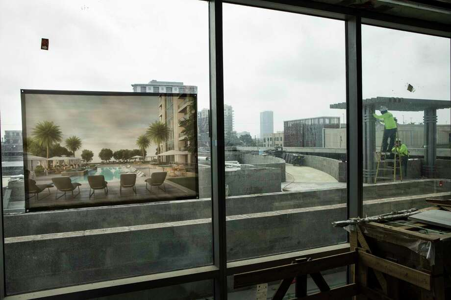 An artist's rendering of the rooftop deck of The Wilshire is shown as construction continues on the high-rise a few blocks from the 2-year-old River Oaks District. The Wilshire already has at least 10 pied-à-terre buyers.  Photo: Brett Coomer, Staff / © 2017 Houston Chronicle