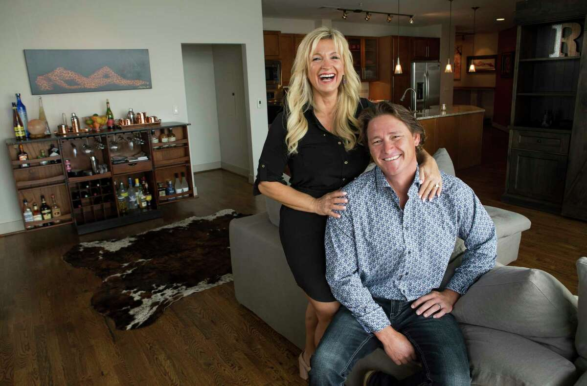 Cory Roper and his wife, Cherie, pose for a portait in their high rise apartment at One Park Place on Wednesday, May 31, 2017, in Houston. The Ropers are part of a trend of folks buying weekend homes in Houston luxury high rises, a trend which has picked up as downtown and uptown have become more fun places to go. ( Brett Coomer / Houston Chronicle )