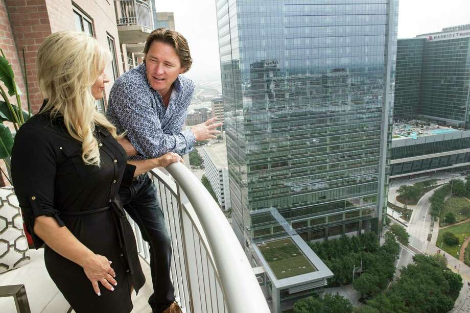 Cherie and Cory Roper enjoy the balcony of their high-rise apartment at One Park Place. The Ropers are part of a trend of folks with weekend homes in Houston luxury towers, lured to the city as downtown and uptown have become more fun. Photo: Brett Coomer, Staff / © 2017 Houston Chronicle