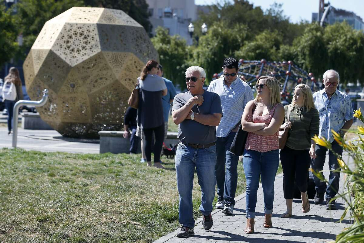 Visitors stroll through Patricia's Green in Hayes Valley park in San Francisco. The neighborhood west of the Civic Center has one of the highest rated walk scores in the city.