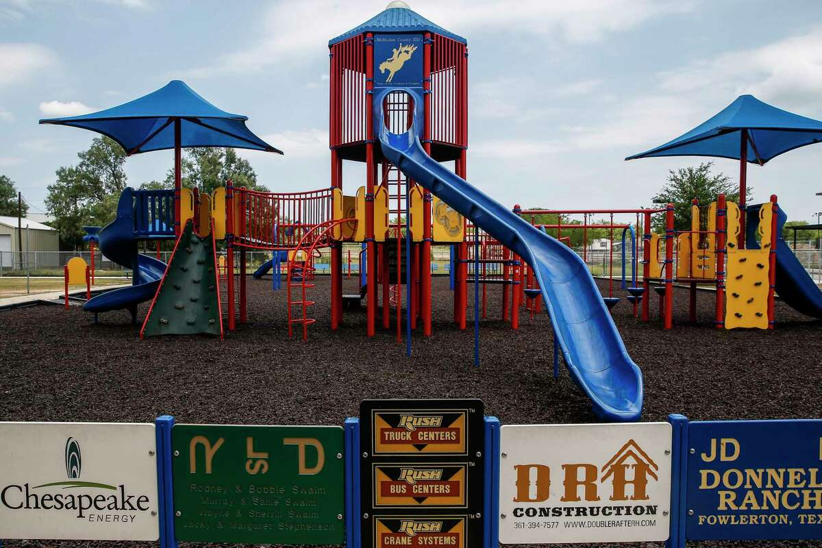 Names of sponsors line a playground at McMullen County ISD Tuesday, May 23, 2017 in Tilden, the county seat of McMullen County. McMullen County, a county of only about 800 residents, had the highest average gross income in the country in 2015. ( Michael Ciaglo / Houston Chronicle )