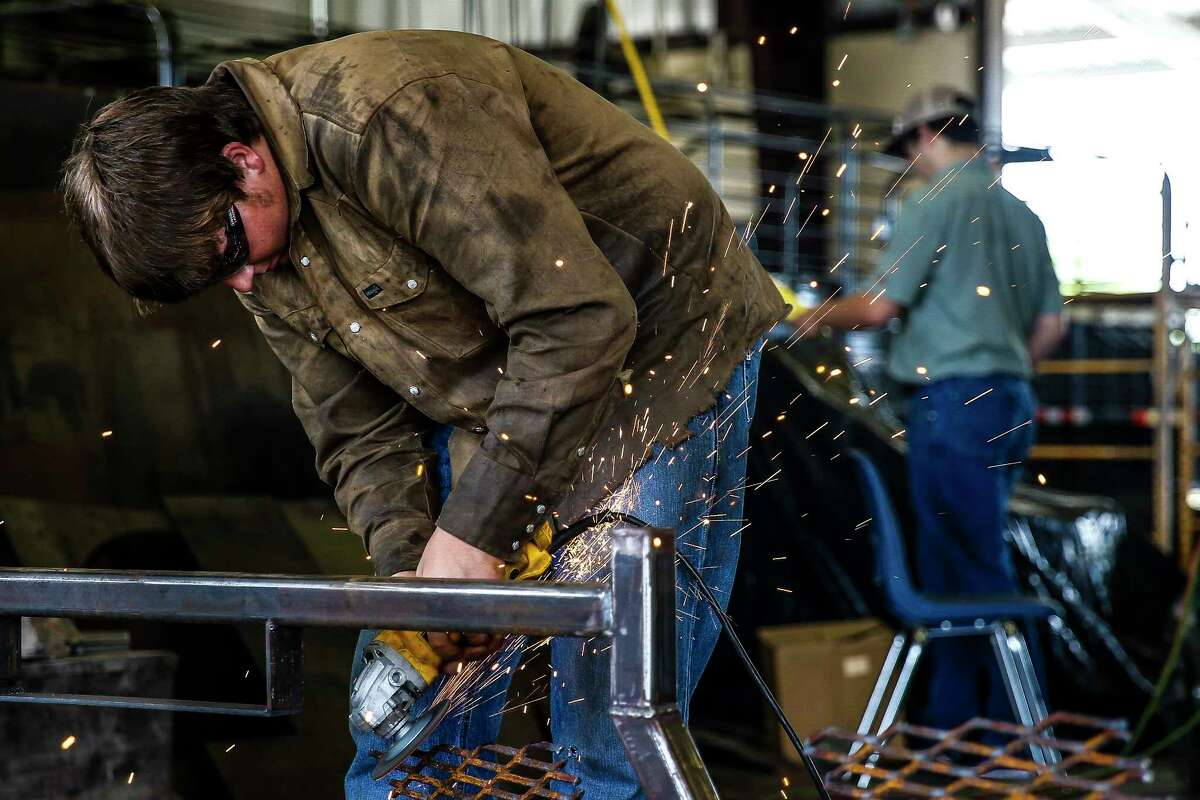 McMullen County High School senior Covy Harper grinds down a grate for a trailer their Agriculture Mechanics class is fixing Tuesday, May 23, 2017 in Tilden, the county seat of McMullen County. McMullen County, a county of only about 800 residents, had the highest average gross income in the country in 2015. ( Michael Ciaglo / Houston Chronicle )