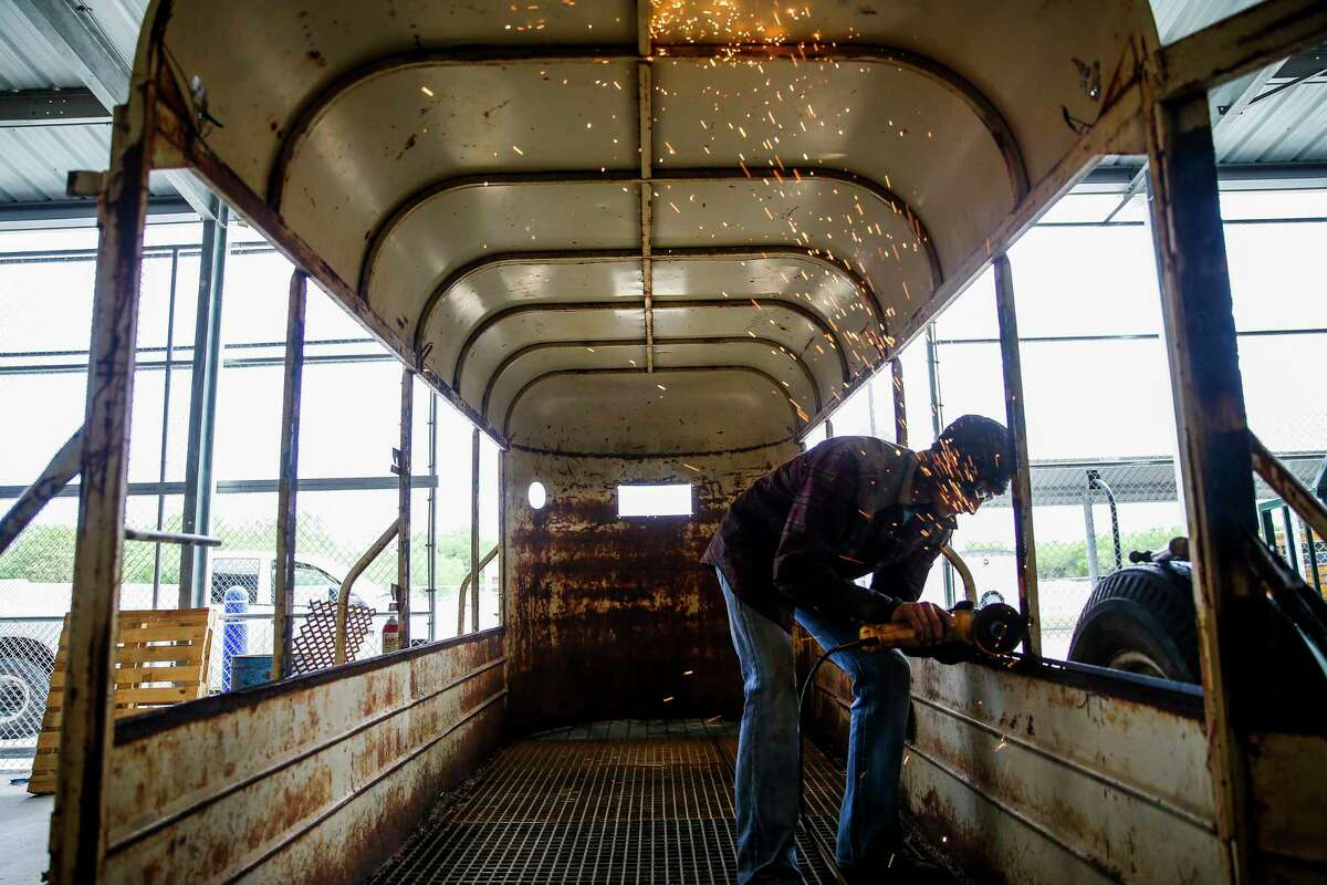 McMullen County High School junior Tyler Allen grinds down part of a trailer that he and his Agriculture Mechanics class is fixing Tuesday, May 23, 2017 in Tilden, the county seat of McMullen County. McMullen County, a county of only about 800 residents, had the highest average gross income in the country in 2015. ( Michael Ciaglo / Houston Chronicle )