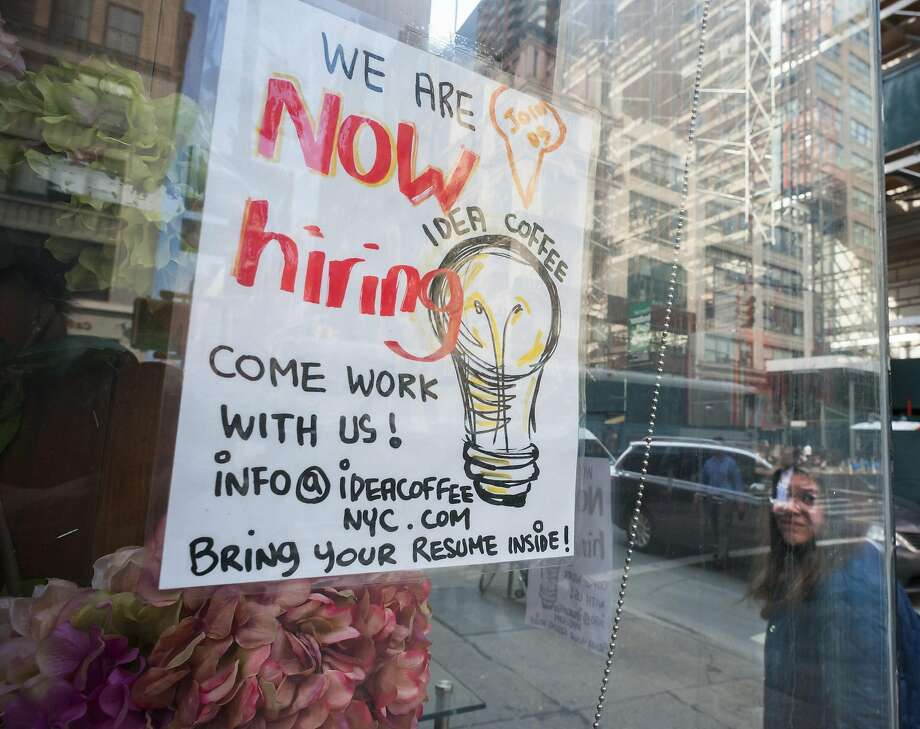 A sign in the window of a Idea Coffee in New York advertises for workers. U.S. job growth was lackluster in May. Photo: Richard B. Levine, TNS