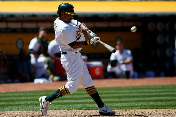 OAKLAND, CA - MAY 20:  Khris Davis #2 of the Oakland Athletics hits a two run home run against the Boston Red Sox during the fifth inning at the Oakland Coliseum on May 20, 2017 in Oakland, California. The Oakland Athletics defeated the Boston Red Sox 8-3. (Photo by Jason O. Watson/Getty Images)