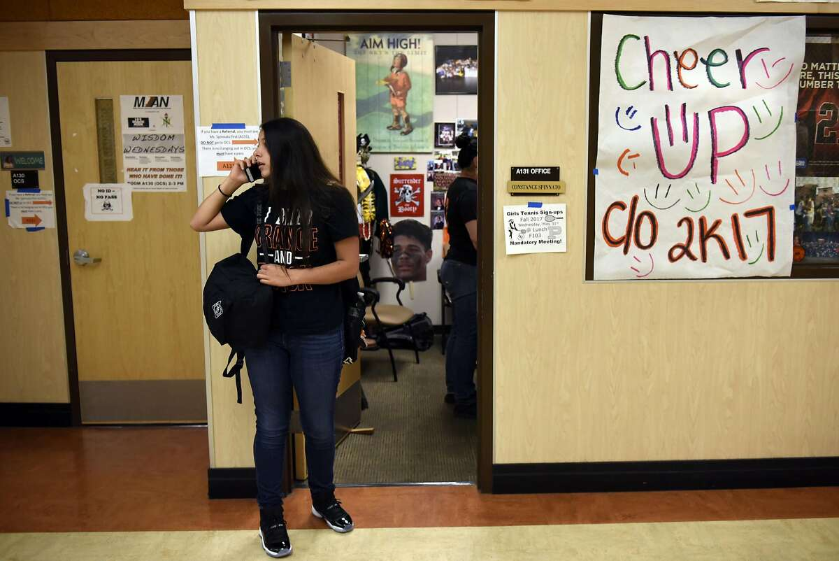 Mareiya Gonzales, 17, looks for her friends in a hallway at Pittsburg High School in Pittsburg, CA, on Friday June 2, 2017.