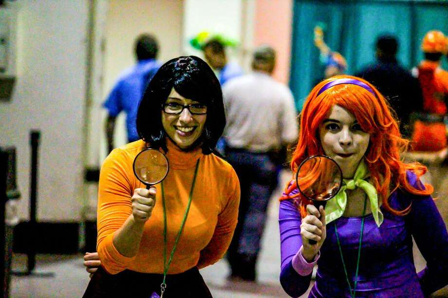 "ComiCONN takes place at Foxwoods Resort Casino on Saturday and Sunday, June 10 and 11. Cosplay is part of the fun; thousands dress in costume as their favorite characters, such as mystery-solving crime fighters Velma and Daphne, seen here, from ""Scooby-Doo, Where Are You!"" Photo: Joe McDonald / ComiCONN / Contributed Photo"