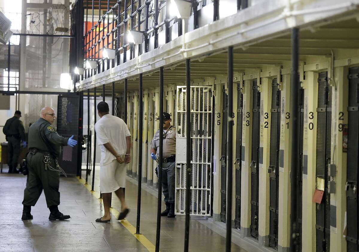 A Death Row inmate in San Quentin State Prison is escorted out of his cell. Gov. Gavin Newsom said he will declare a moratorium on California's death penalty and grant reprieves to 737 condemned prisoners on the nation's largest Death Row. The move comes more than two years after the state's voters rejected an initiative to abolish capital punishment.