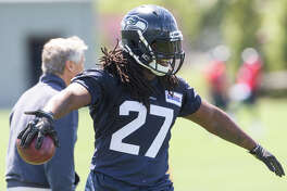 Seahawks running back Eddie Lacy smiles after an interaction with head coach Pete Carroll during the Seahawks' first OTA of the season at Virginia Mason Athletic Center on Friday, June 2, 2017.
