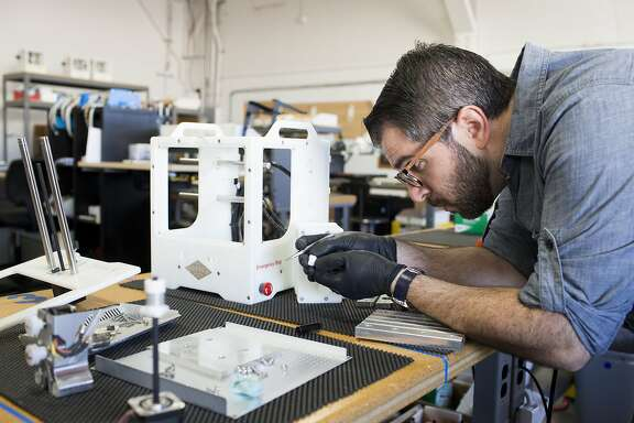 Lead manufacturing technician Kevin Zameni upgrades a customer's machine at Other Machine Co. on Friday, June 2, 2017 in Berkeley, Calif.