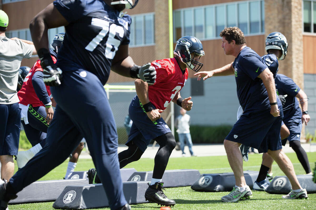 Seahawks quarterback Russell Wilson runs a drill during the Seahawks' first OTA of the season at Virginia Mason Athletic Center on Friday, June 2, 2017.