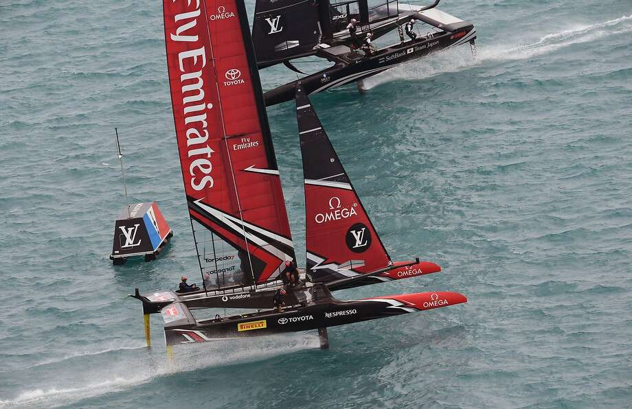 In this photo provided by the America's Cup Event Authority, Emirates Team New Zealand and SoftBank Team Japan compete during America's Cup qualifying on the Great Sound in Bermuda on Friday, June 2, 2017.  (Richard Pinto/ACEA via AP) Photo: Richard Pinto, Associated Press