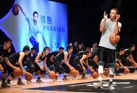 "National Basketball Association (NBA) Golden State Warriors 2014-2015 season MVP Stephen Curry takes part in a basketball clinic with Japan's Under-18 players in Tokyo on September 4, 2015. Curry started his three-nation (Japan, China and Philippines) Under Armour Asia tour to promote the company's limited basketball shoes, ""UA Curry II"".  AFP PHOTO / TOSHIFUMI KITAMURA        (Photo credit should read TOSHIFUMI KITAMURA/AFP/Getty Images)"
