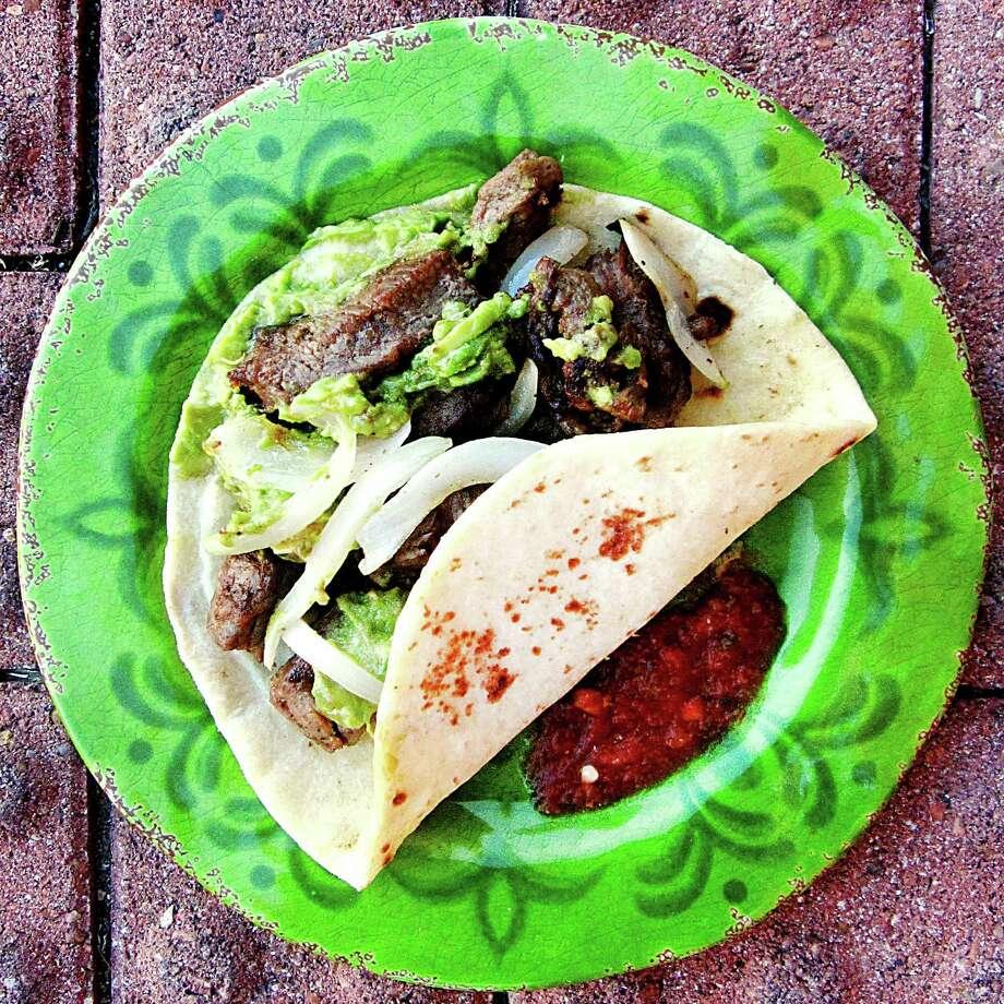 Beef fajita with guacamole taco on a handmade flour tortilla from Tink-A-Tako. Photo: Mike Sutter /San Antonio Express-News