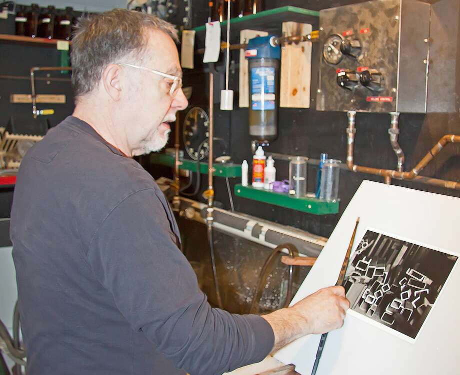 Stephen Grewe, a Filion area photographer, working in his darkroom. Photo: Bill Diller/For The Tribune