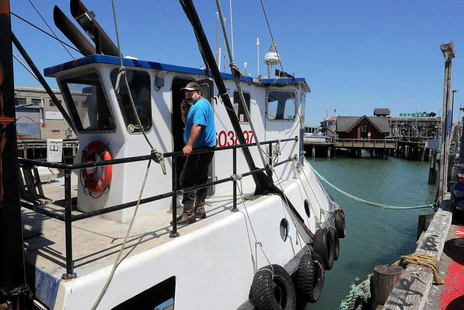 Joe Pennisi, on his fishing trawler F/V Pioneer on Fisherman's Wharf, favors being allowed to sell fish wholesale from his boat. Photo: Michael Macor, The Chronicle