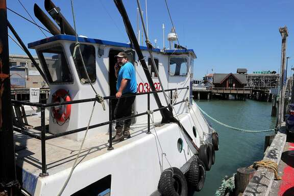 "Joe Pennisi on his fishing boat the ""Pioneer"", along Fisherman's Wharf  in San Francisco , Ca., as seen on Thursday June 1, 2017.�A battle is going down on Fisherman's Wharf over discussions that the port of San Francisco allow fishermen to sell fish (but not crab) directly from the boat."