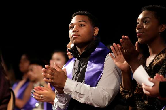 Darius Aikens, (center) of Oakland high school, who is headed for UCLA joined 400 other high school students who are graduates of the Oakland Promise Program, gathered at the Scottish Rite Temple in Oakland, Ca.,on Wednesday May 31, 2017, for an awards ceremony. The students are set to head to college with money provided from the Oakland Promise program and the East Bay College Fund.