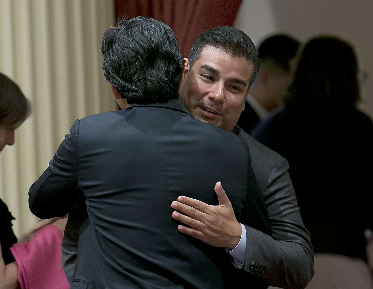 State Sen. Ricardo Lara, D-Bell Gardens, right, is congratulated by Senate President Pro Tem Kevin deLeon after his single-payer health care plan was approved by the Senate, Thursday, June 1, 2017, in Sacramento, Calif. The longshot bill cleared a big hurdle Thursday when Senate Democrats voted 23-14 to send it to the state Assembly. (AP Photo/Rich Pedroncelli)