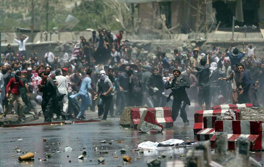 Demonstrators and police clashed Friday in Kabul amid a protest, attended by more than 1,000 people, demanding better security after a truck bomb attack Wednesday. Photo: Massoud Hossaini, STF / Copyright 2017 The Associated Press. All rights reserved.