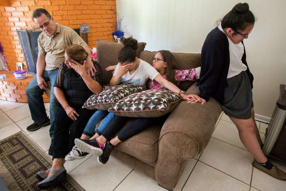 Juan Rodríguez and his family - wife Celia and daughters Karen, Kimberly and Rebecca - have built a life in Houston. That could change at month's end because Juan has been ordered to turn himself in to be deported to El Salvador.  Photo: Marie D. De Jesus, Staff / © 2017 Houston Chronicle