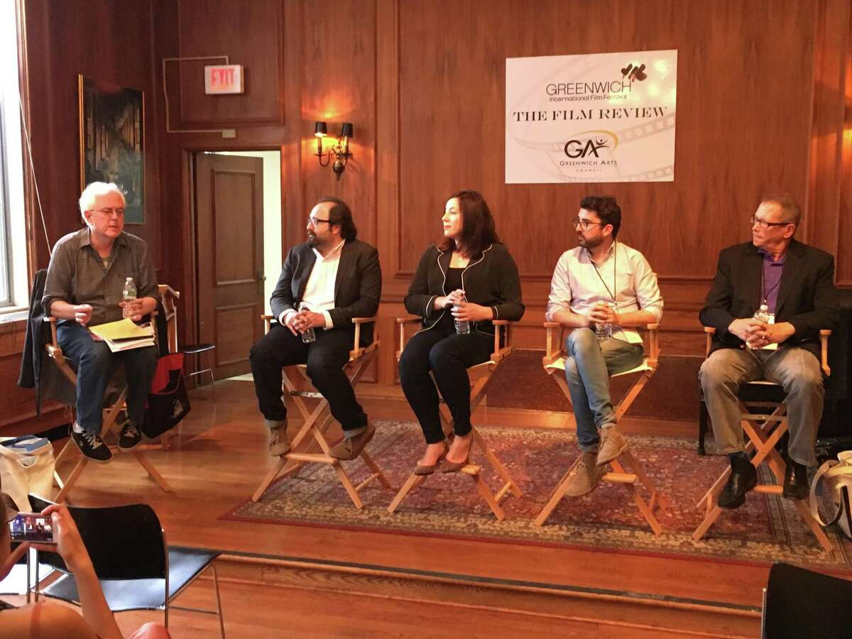 Joe Meyers, left, asks film critics about their responsibilities, as Chris Nashawaty, Alison Willmore, Richard Lawson and Marshall Fine consider their answers.