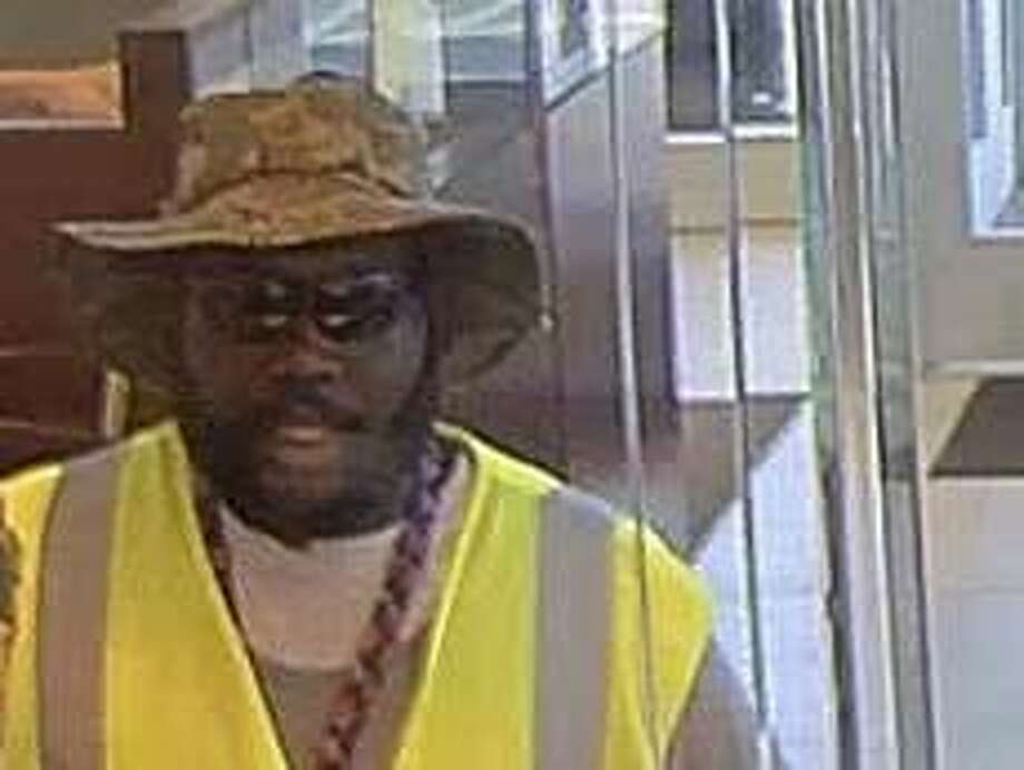 The FBI and Crime Stoppers Houston are searching for a bearded bank robber recorded robbing a Houston Wells Fargo Bank on June 1, 2017. Photo: FBI