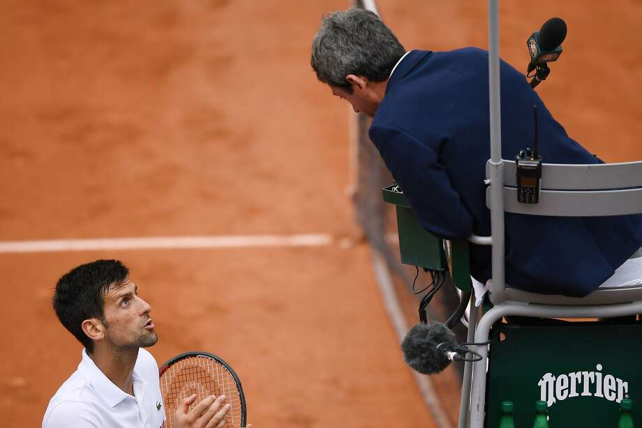 Novak Djokovic pleads his case to the chair umpire during his match with Argentina's Diego Schwartzman. The second-seeded Djokovic won 5-7, 6-3, 3-6, 6-1, 6-1. Photo: LIONEL BONAVENTURE, AFP/Getty Images