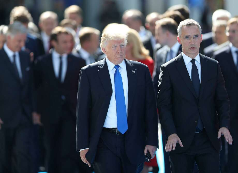 The refusal of President Donald Trump (with NATO Secretary-General Jens Stoltenberg and other world leaders in Brussels) to reaffirm the U.S. commitment to Article 5 undermines its deterrence value. Photo: Jasper Juinen /Bloomberg News / Bloomberg
