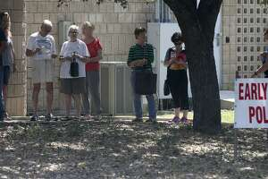 People line up to vote Tuesday May 30, 2017 at the Brook Hollow Branch Public Library. Voters have a chance to cast ballots for mayoral and City Council runoff races starting today at one of 25 polling places. Polls will be open from 8 a.m. until 6 p.m. Tuesday through Saturday and from 8 a.m. to 8 p.m. on June 5 and June 6.