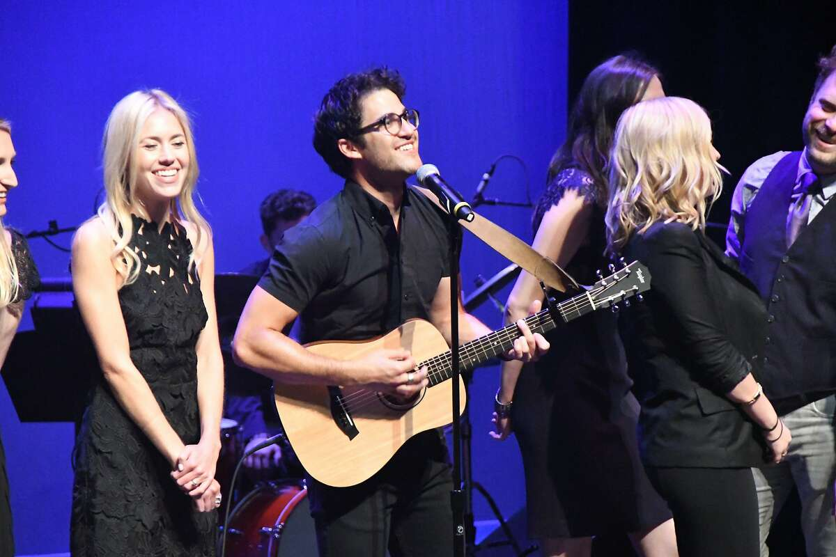 Darren Criss, joined by Young Conservatory alums, perform a song at Craig Slaight�s farewell celebration held at ACT�s Strand Theater on Monday, May 22.