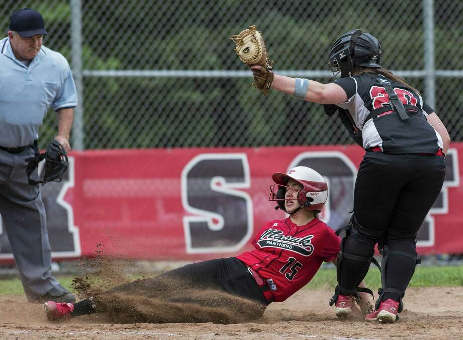 Masuk High School's Erica Pullen is called out at home after Fitch High School catcher Taylor Wolfgang tags her at the plate during a CIAC quarterfinal round class L softball game played at Masuk High School, Monroe, CT. Friday, June 2, 2017. Photo: Mark Conrad / For Hearst Connecticut Media / Connecticut Post Freelance