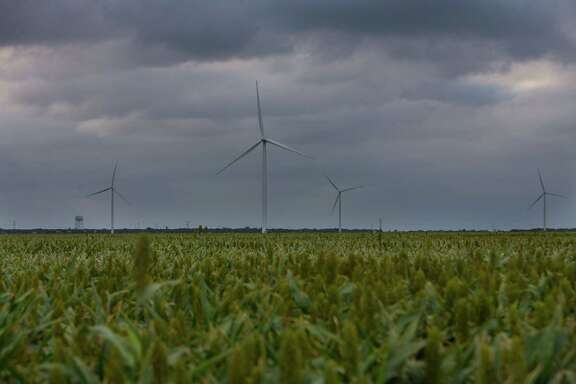 Wind turbines that are part of the Papalote Creek Wind Farm turn near Taft, TX above a field of sorghum, Tuesday, May 16, 2017, in San Patricio County. (Mark Mulligan / Houston Chronicle)