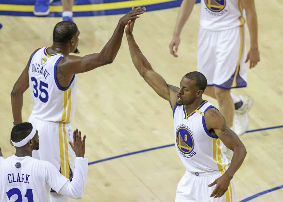 Golden State Warriors' Kevin Durant and Andre Iguodala high five during a first quarter timeout during Game 1 of the 2017 NBA Finals at Oracle Arena on Thursday, June 1, 2017 in Oakland, Calif. Photo: Scott Strazzante / The Chronicle / online_yes