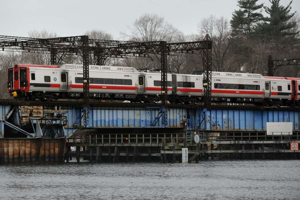 A Metro-North train crosses the Saugatuck River bridge, in Westport, Conn., Jan. 2, 2014.