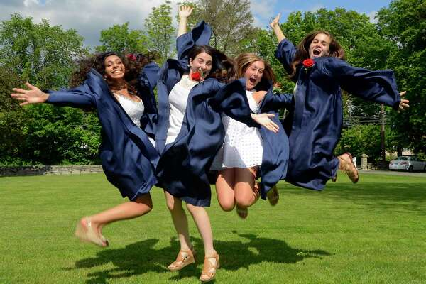 From left Valedictorian Nisha Chandra, along with her fellow graduates Kayla Lichtman, Megan Glinka and Cara Shattan jump for fun as a friend takes a photo prior to King School's Class of 2017 Commencement Exercises at the school in Stamford, Conn., on Friday June 2, 2017.
