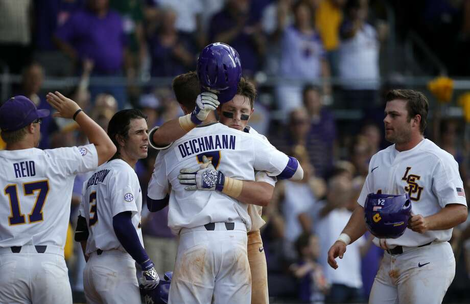 LSU's Michael Papierski, facing, hugs Greg Deichmann (7) after Papierski's two-run homer in the seventh inning of a game against Texas Southern at the LSU Regional of the NCAA college baseball tournament in Baton Rouge, La., Friday, June 2, 2017. LSU won 15-7. (AP Photo/Gerald Herbert) Photo: Gerald Herbert/Associated Press