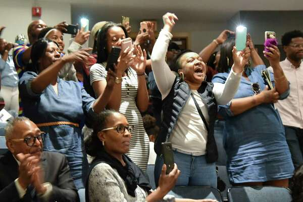 Family and supporters cheer for Capital Prep Harbor School graduates during their second annual commencement on Friday, June 2, 2017 in The Arnold Bernhard Arts Recital Center on the University of Bridgeport campus.