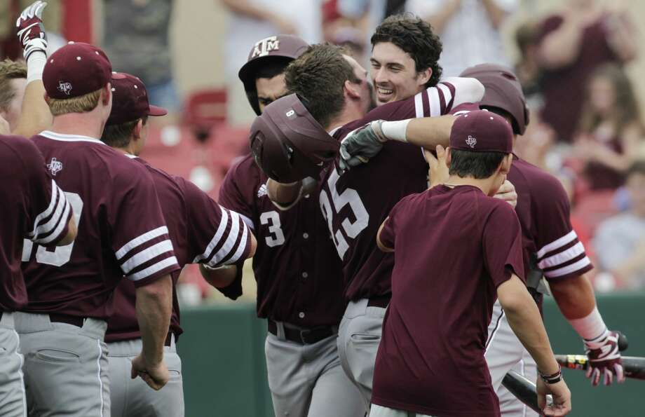 Texas A&M players come out to celebrate Braden Shewmake's (8) two-run homerun during the 2017 NCAA Regional game at Darryl and Lori Schroeder Park Friday, June 2, 2017, in Houston. ( Yi-Chin Lee / Houston Chronicle ) Photo: Yi-Chin Lee/Houston Chronicle
