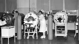 Nurses tended to polio patients in iron lung respirators at the Robert B. Green Memorial Hospital polio ward in San Antonio in 1950. It was a common scene throughout the polio crisis that swept Texas.